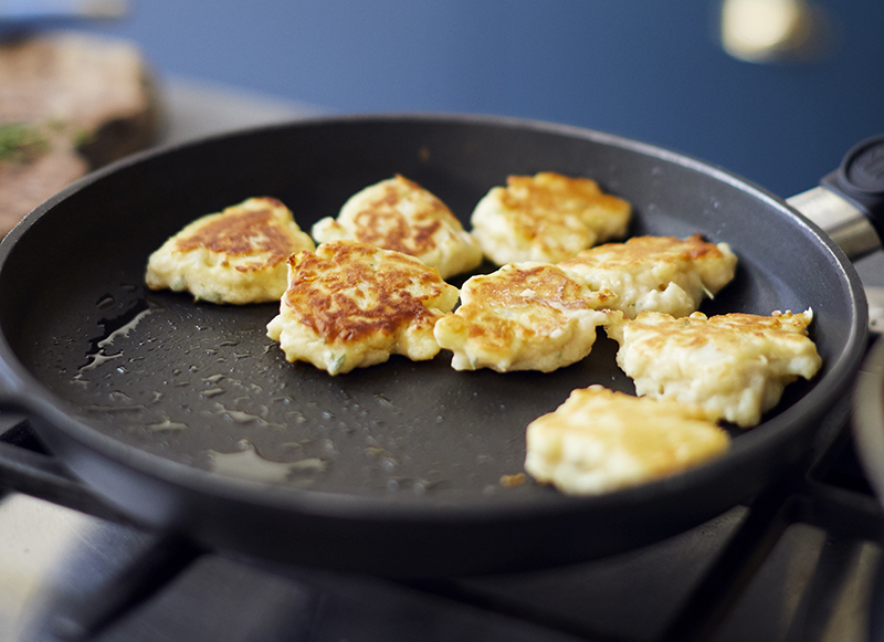 Cauliflower cheese fritters in pan