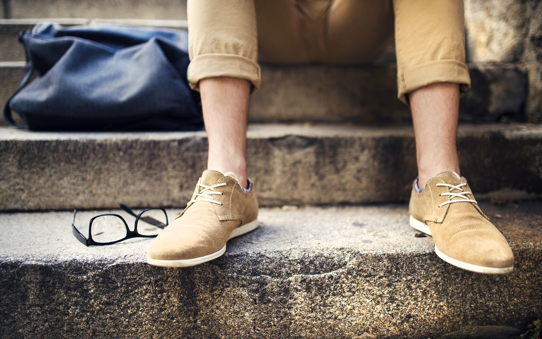 Graphicstock Detail Of Modern Hipster Mans Feet Sitting On The Stairs H0 Nhz8 E3 Wz