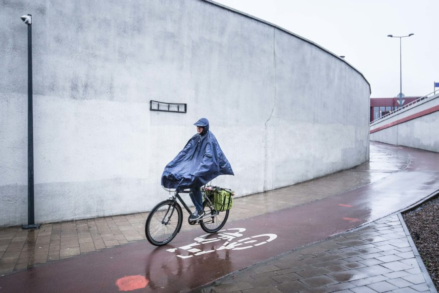 Cyclist in rain coat krakow
