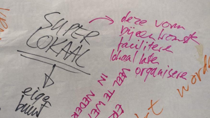 Tafelkleedtekst: 'Superlokaal -> eigen buurt'
