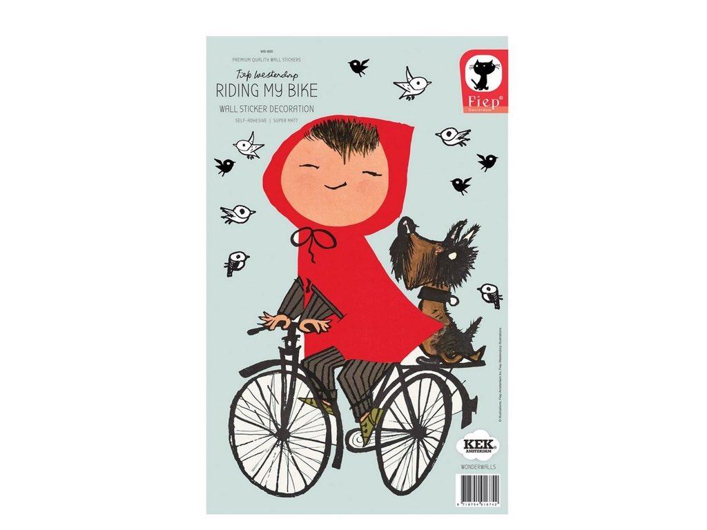 Muursticker van meisje op fiets