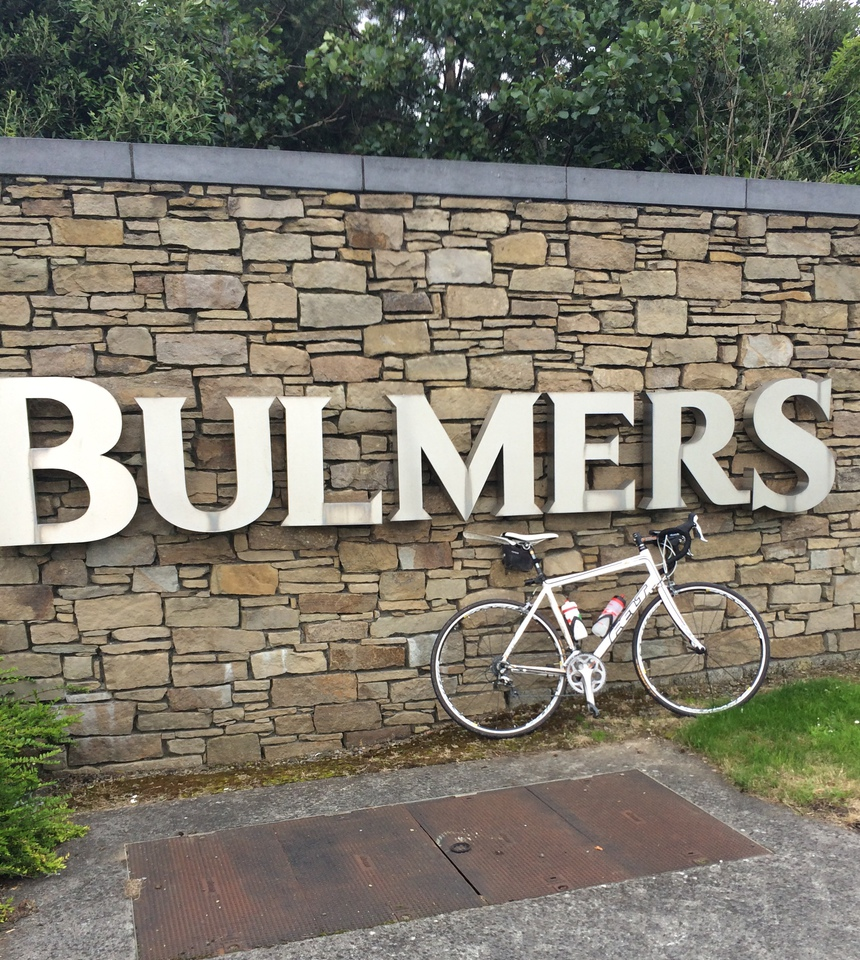 John's bike beneath the Bulmers factory sign
