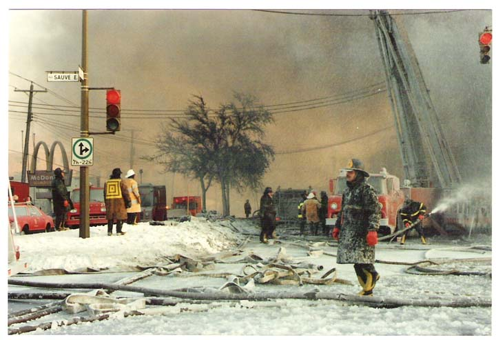 Icy photo of Montreal Fire fighters at work
