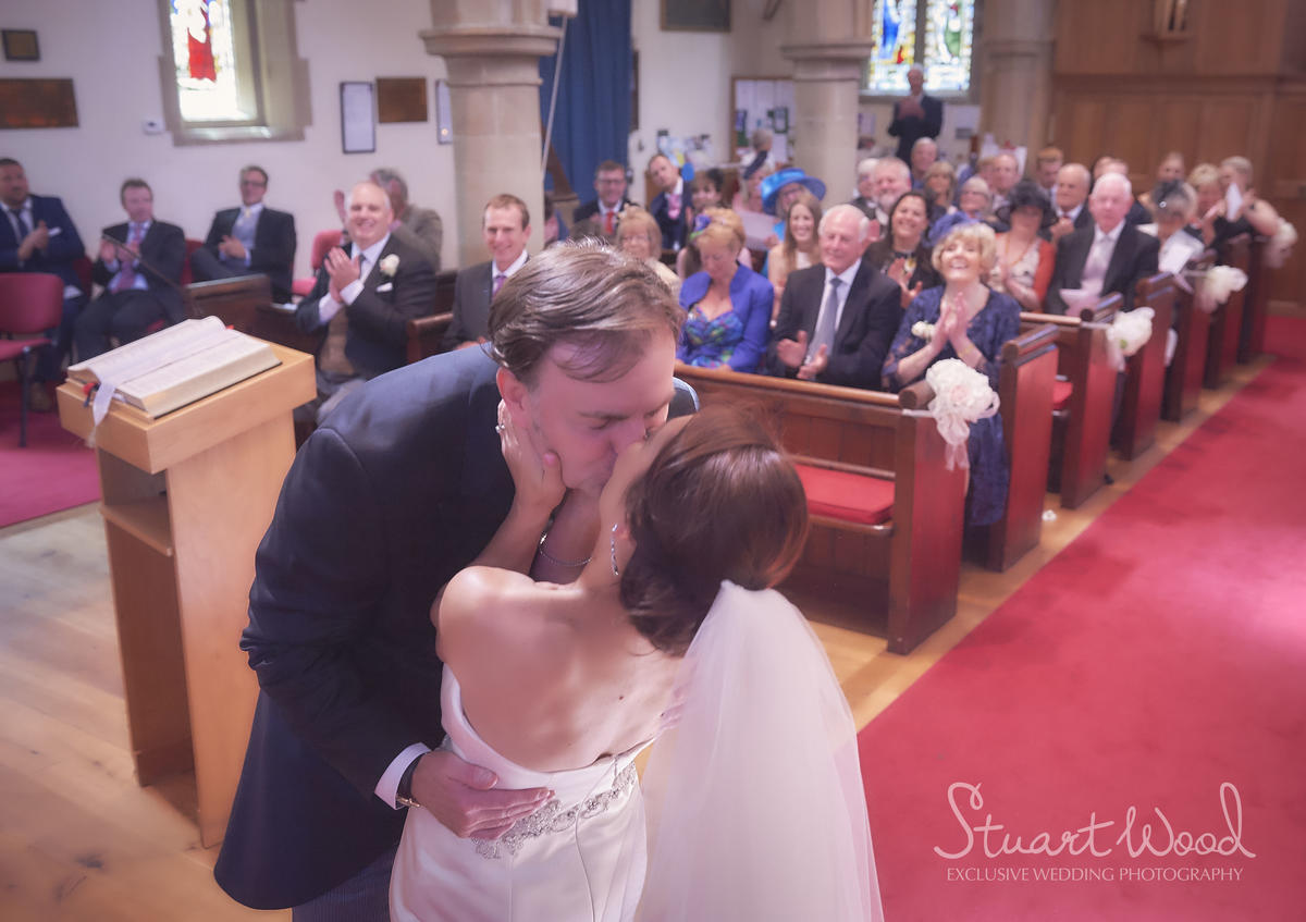 Stuart Wood Weddings / New Bath Hotel Matlock Weddings / Simon & Georgina / Altar Kiss