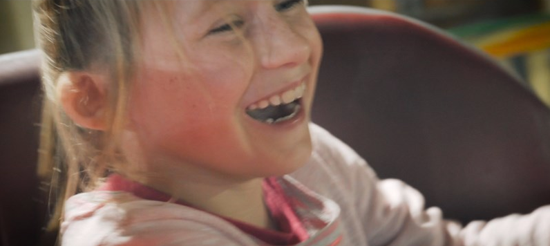 laughing girl on waltzers
