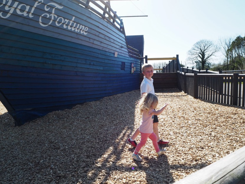 Girl playing on pirate ship at Folly Farm