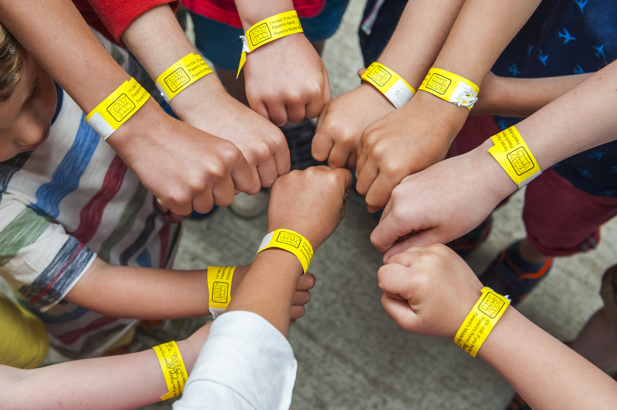 Children wearing lost child wristbands
