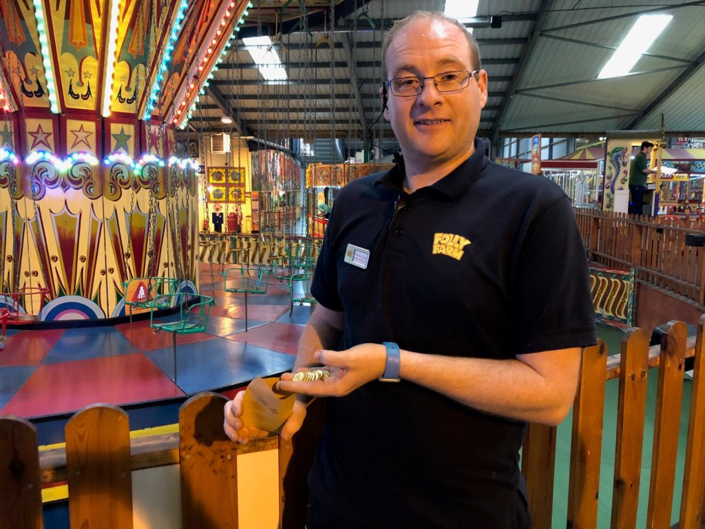 Man with fairground tokens