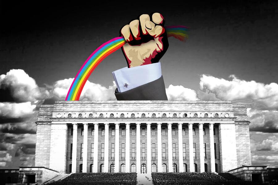 Sateenkaarta nyrkissään pitävä käsi eduskuntatalon päällä