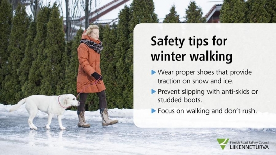 Woman walking with a dog on a slippery road. Text box: - wear proper shoes with traction on snow and ice - prevent slipping with anti-skids or stubbed boots - focus on walking and don`t rush.