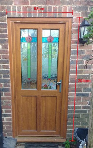 Light Oak Upvc Front Door With Flemish Coloured Glazing In Lewes