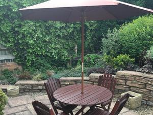 Round Wooden Patio Table And Four Chairs In Bristol