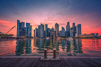 Singapore skyline and view of business district downtown with wooden walkway