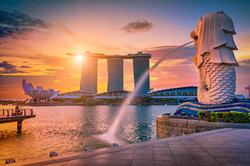 Merlion statue fountain in merlion park and singapore city skyline . one of the most famous tourist attraction in singapore