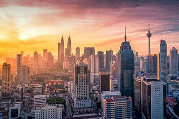Kuala lumpur skyline and skyscraper with highway road Premium Photo