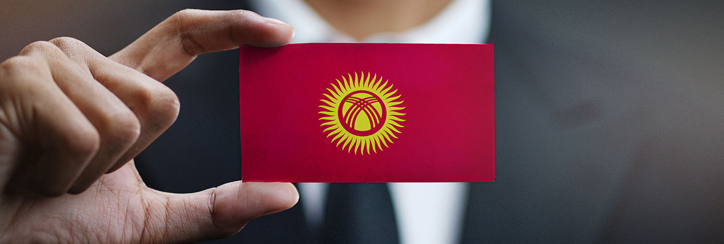 Businessman holding card of kyrgyzstan flag