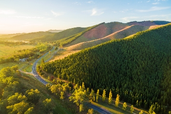 Winding road passing through beautiful australian countryside at sunset
