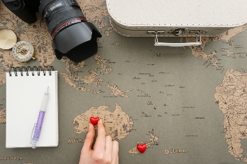 Travel background with hand placing a heart in australia