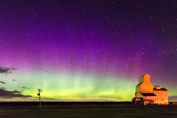 Aurora borealis northern lights over a historic grain elevator