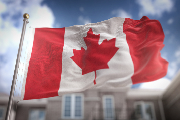 Canada flag 3d rendering on blue sky building background