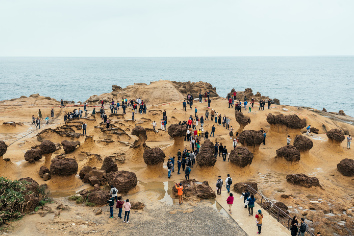 Diversity of tourists walking in yehliu geopark, a cape on the north coast of taiwan