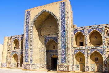 Side view of ulugbek medressa, the oldest madrasa of central asia, in bukhara, uzbekistan.