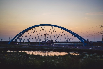 Sunset bridge over the road.