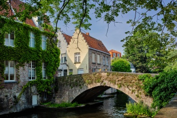 Brugge canal and old houses and tree. bruges, belgium