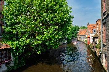 Tourist boat in canal. brugge bruges, belgium