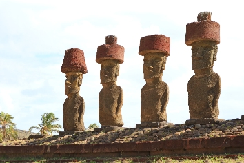 Four of seven gigantic moai of ahu nau nau, anakena beach, easter island, chile