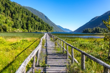 Wooden bridge across river murta, landscape with beautiful mountains view, patagonia, chile, south america