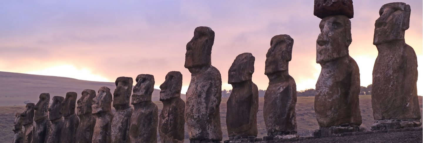 Gigantic 15 moai statues of ahu tongariki against beautiful sunrise cloudy sky, easter island, chile