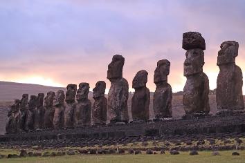 Gigantic 15 moai statues of ahu tongariki against beautiful sunrise cloudy sky, easter island, chile