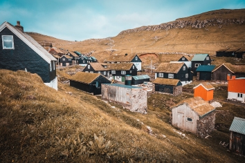 Group of houses with grass roof in the village of mykines