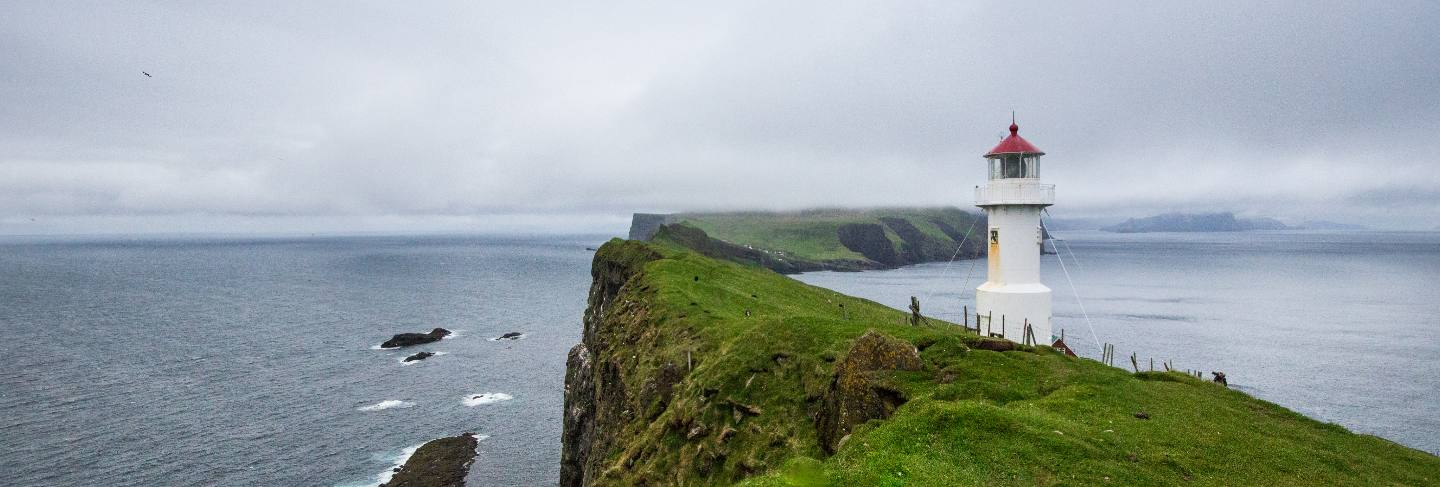 Mykines lighthouse, faroe islands. foggy view of old lighthouse