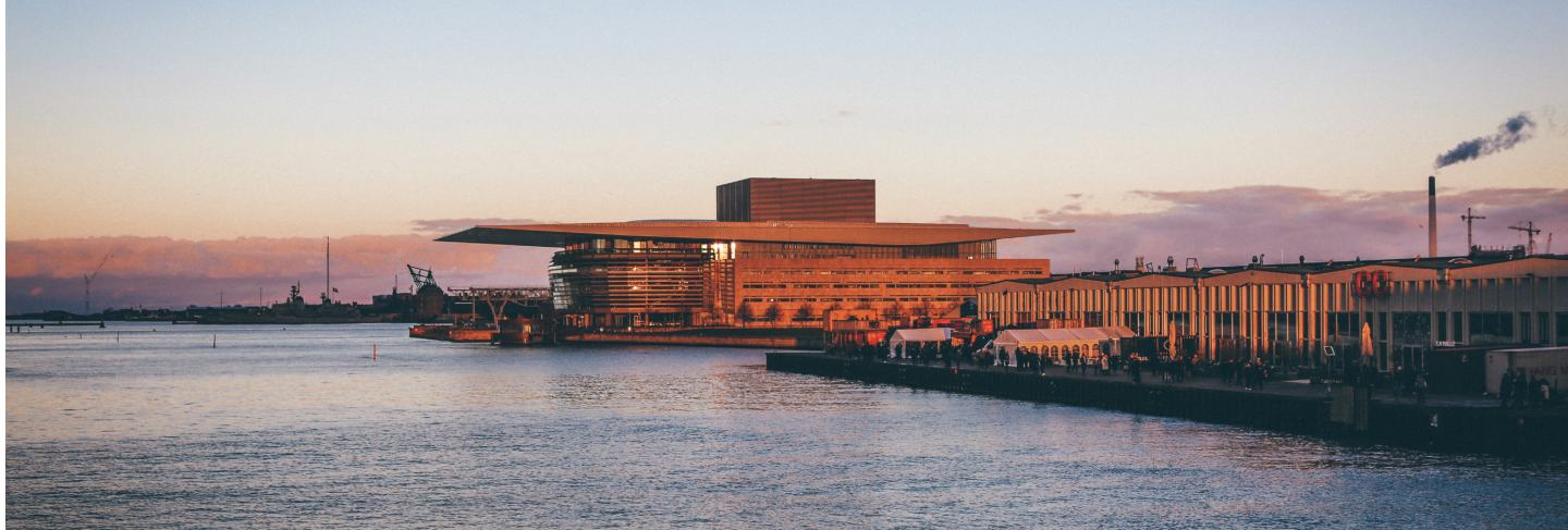 Wide shot of copenhagen opera house and street food markets by the body of water