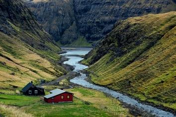 Small colored houses, fjords and the sea coast on faroe islands