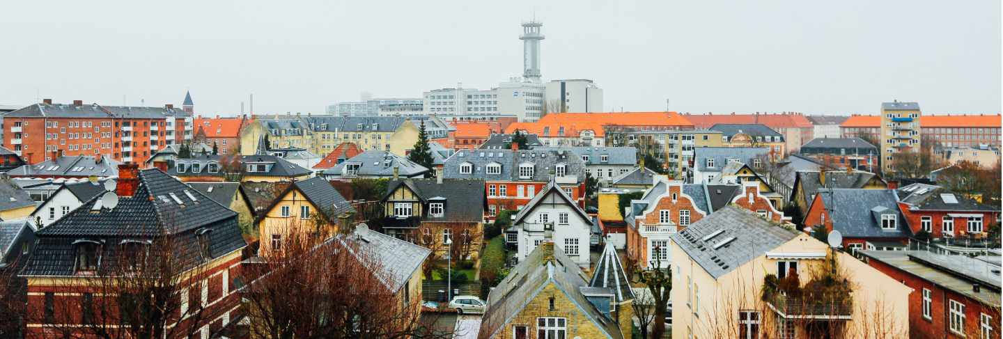 Wide shot of houses and buildings in the city of copenhagen, denmark
