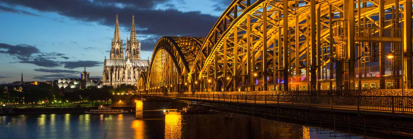 Famous cathedral and bridge in cologne at twilight