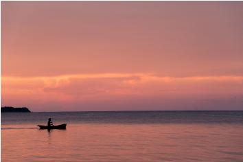 Beautiful sunset on the beach and silhouette boat, samui island thailand