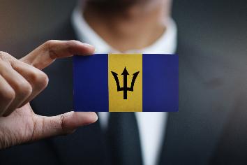 Businessman holding card of barbados flag