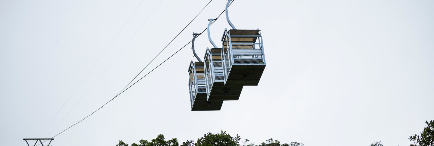 Three empty cable car over rainforest at costa rica