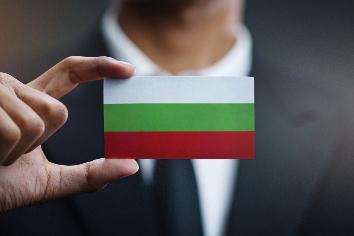 Businessman holding card of bulgaria flag