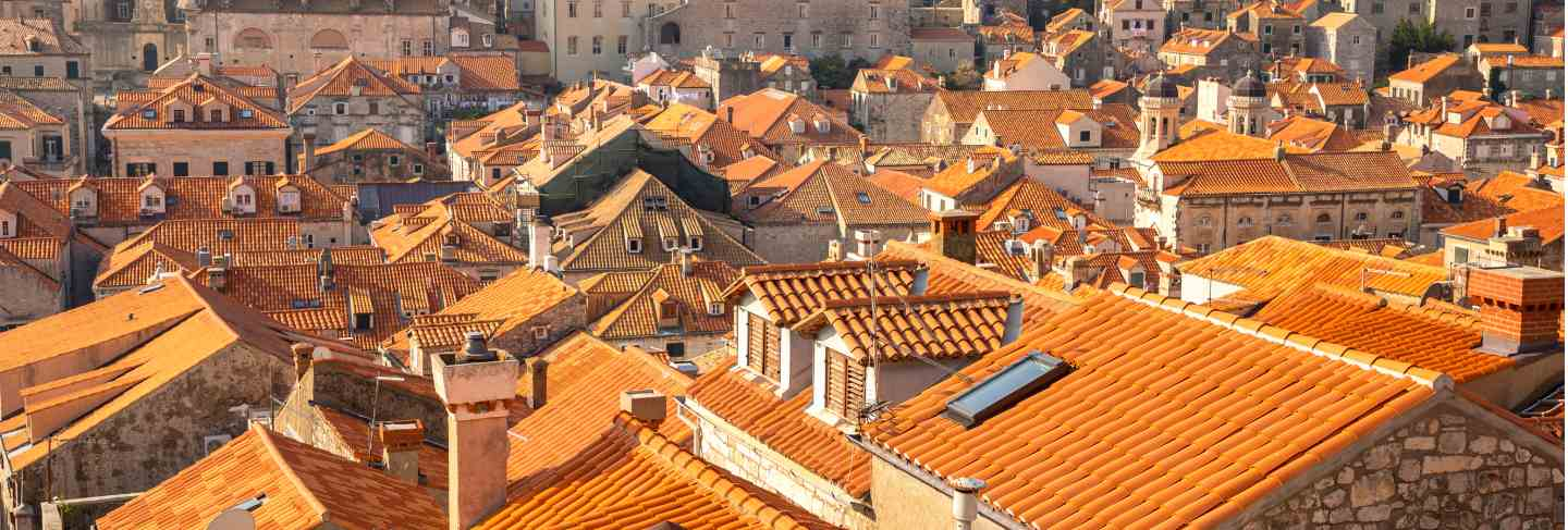 View of dubrovnik red roofs in croatia at sunset light