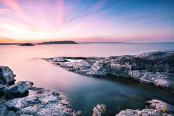 Textured stone island under dawn sky