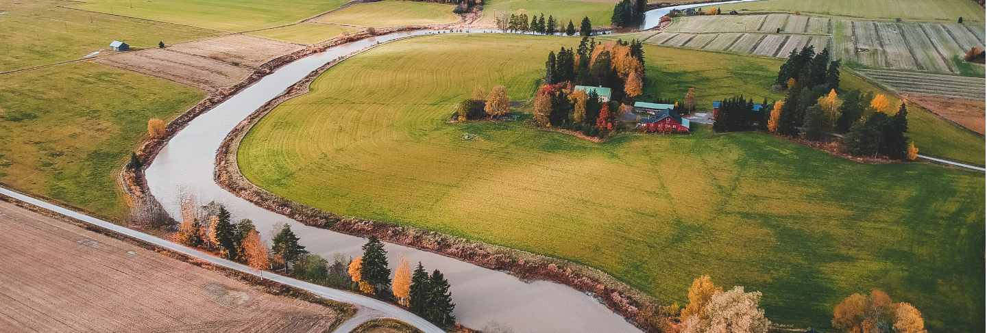 Aerial view of fertile plowed fields and forests. photo taken from a drone. finland, pornainen