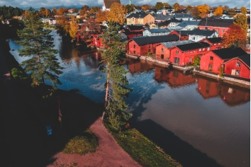 Aerial view of the old red house and barns by the river