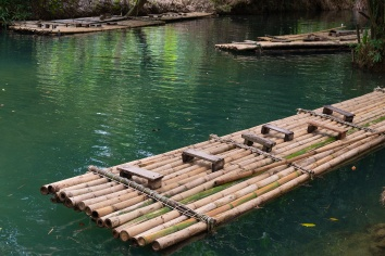 Bamboo raft a way to travel by water. the human used since ancient times. waterfall in tha