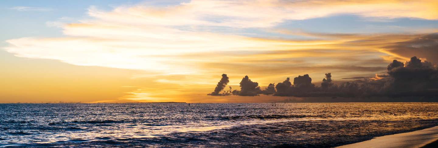 Sunset on the ocean. beautiful bright sky, reflection in water, waves