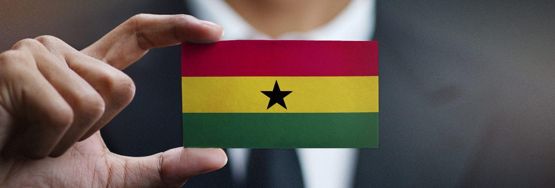Businessman holding card of ghana flag